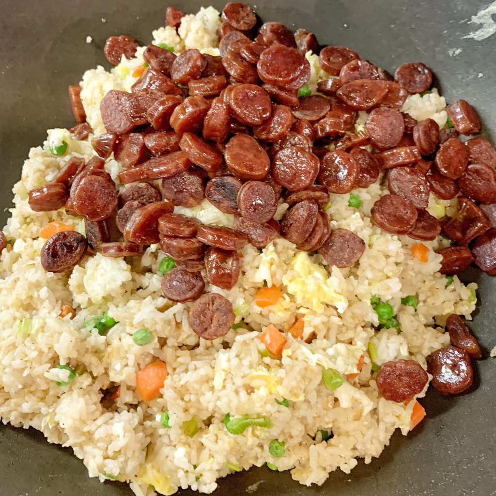 Chinese Sausage fried rice cooking in the wok