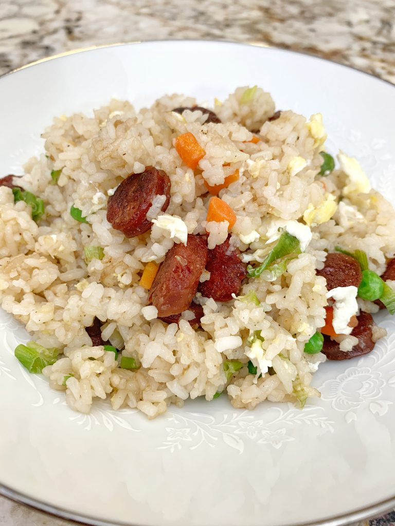 Closeup of Chinese Sausage Fried Rice on a white bowl