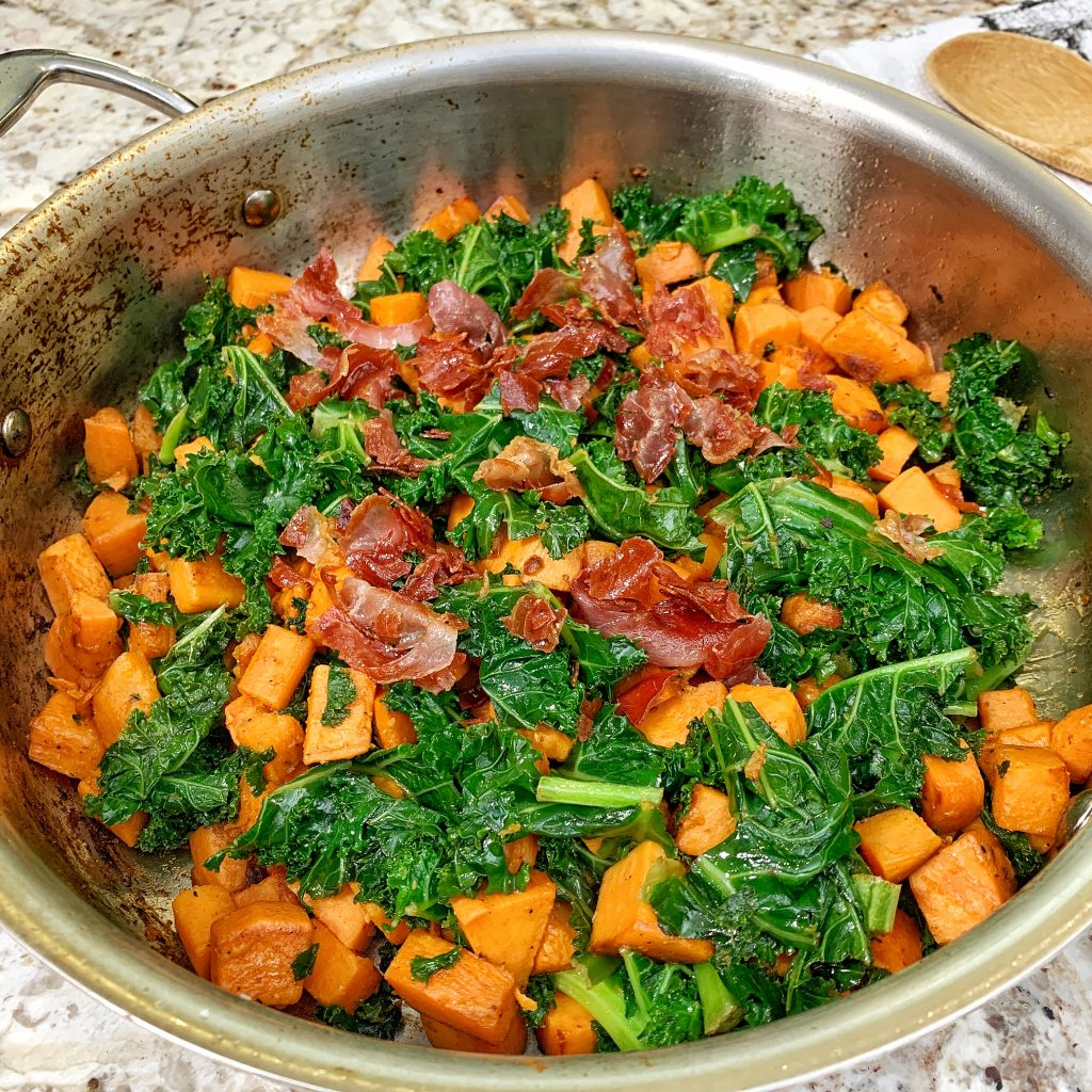 Sweet potato, kale and prosciutto on All-Clad pan