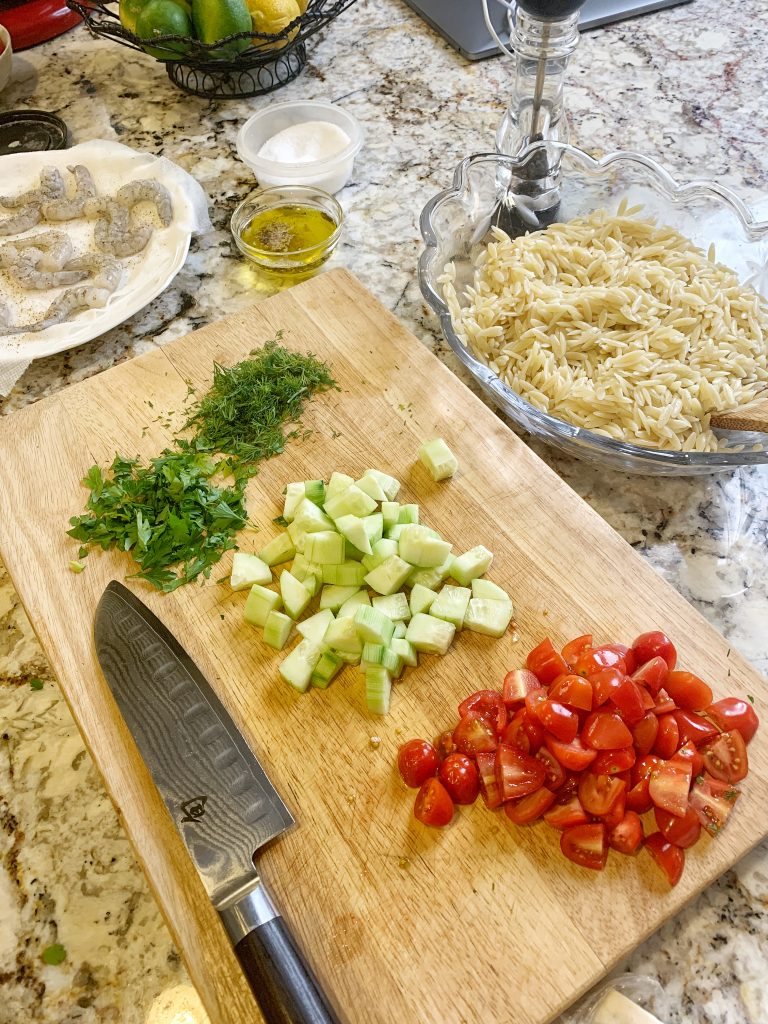 Chopped up tomatoes, cucumbers, dill and parsley.
