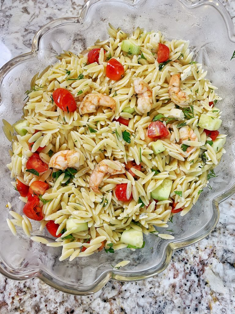 Shrimp and Orzo pasta salad in a clear bowl
